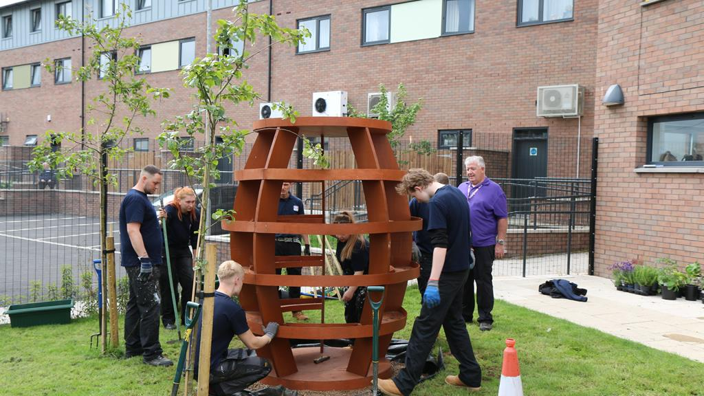 RBH apprentices install a new planter at the Strand Hub